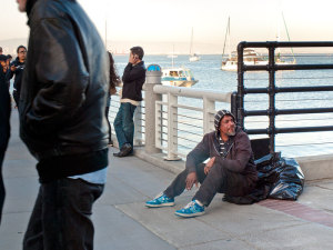 """Homeless Gulf War veteran Joe """"Cooker"""" Jones sitting outside AT&T Park in San Francisco, a site he says he frequents often."""
