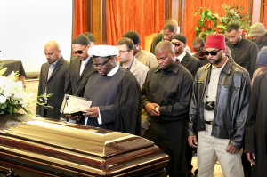 Friends and family gather to perform the Janaza, or funeral prayer, for Shabazz.