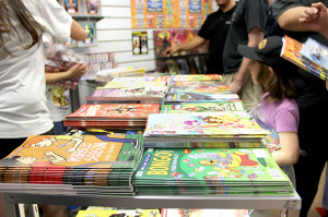 Young comic reader searches for an ideal comic on Free Comic Book Day.