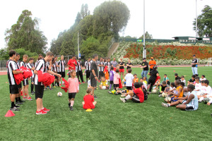 The CSU East Bay men's soccer team handed out t-shirts to the youth in attendence.