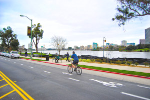 A cyclist rides his bike around Oakland's Lake Merrit.