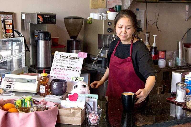 Yamaguchi+serves+an+unsweetened+fresh+latte+in+a+mug.