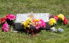 Flowers left by loved ones from Easter.