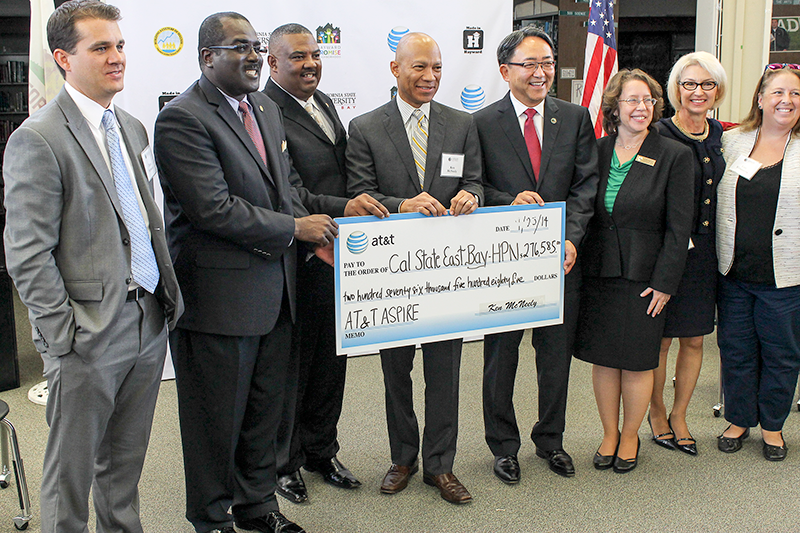 CSUEB and Hayward Unified School District officials accepting AT&T grant at Hayward  High School on Sept. 23.