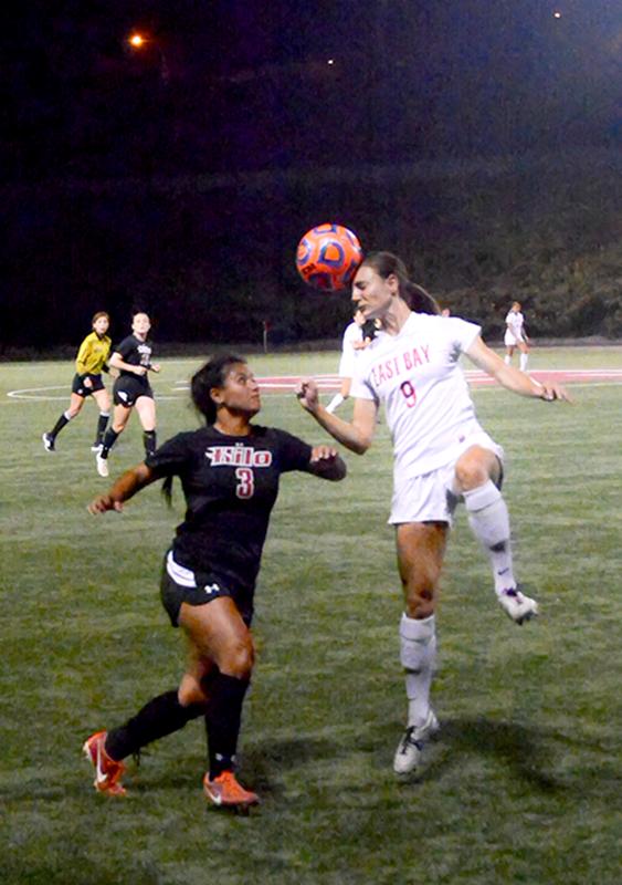 Suzanne Bateson heads the ball.