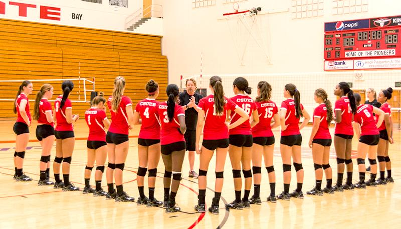Women%E2%80%99s+volleyball+coach+Jim+Spagle+addresses+his+team+on+Tuesday+at+Pioneer+Gymnasium+during+practice.+