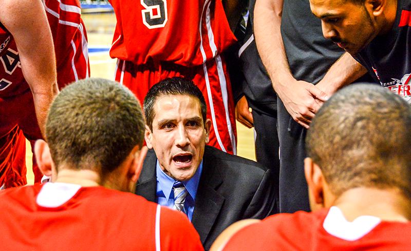 CSUEB coach Gus Argenal motivates his team during a time out.