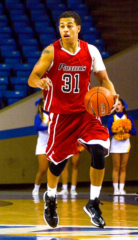 Junior Tre Mauldin runs the offense for CSUEB in an exhibition game against SJSU last month.
