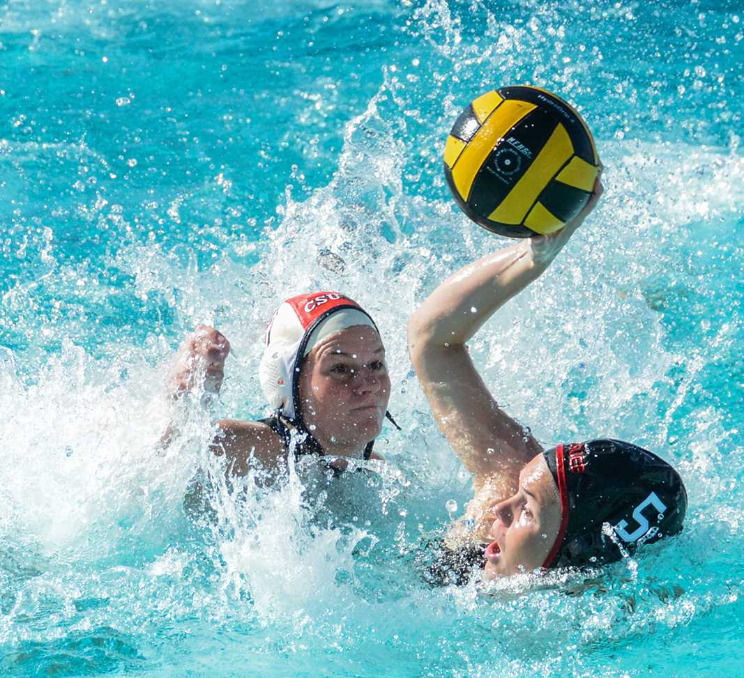CSUEB driver Casey Rushforth shoots the ball against a CSUMB defender Saturday at Pioneer Pool.