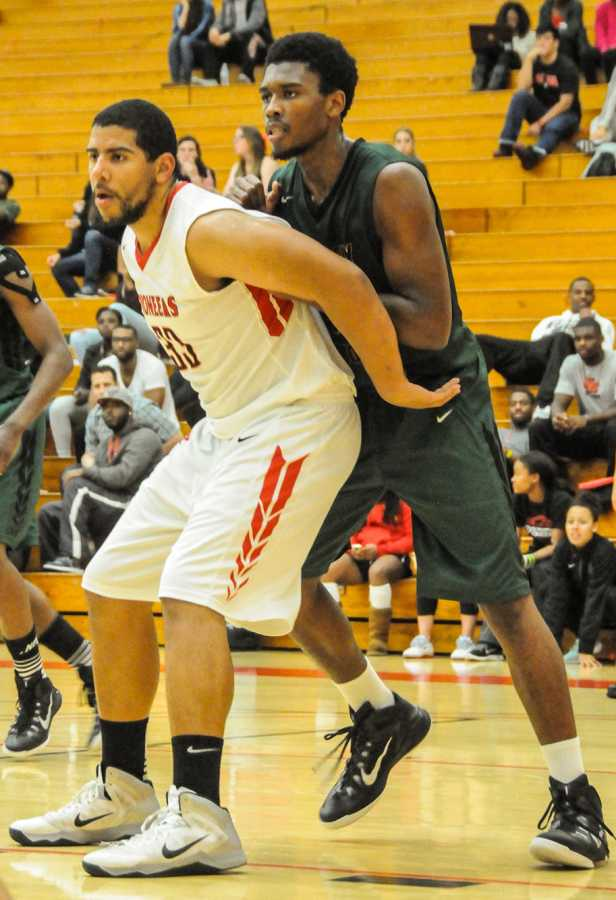 Senior forward Darrick McIntosh posts up in the paint last month at Pioneer Gymnasium.