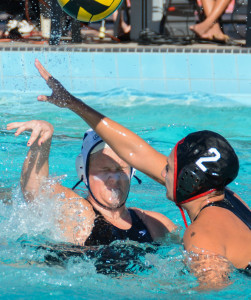 Junior utility player Sabrina Hatzer (right) blocks a pass from a CSU Monterey Bay player last month.