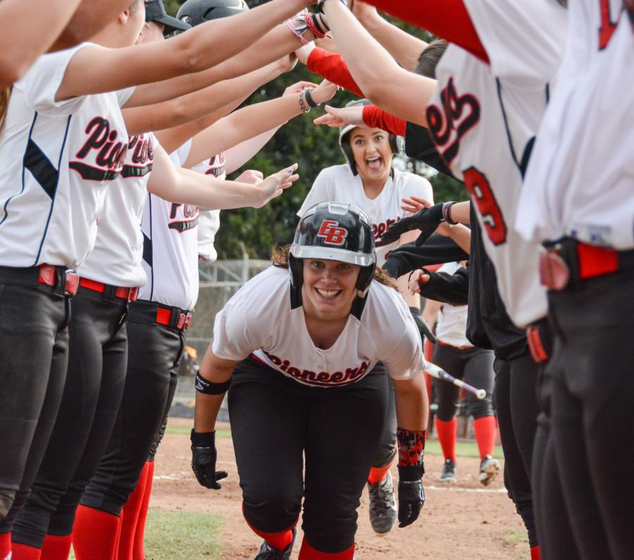 Sophomore+Ali+Cerminara+celebrates+with+her+teammates+after+scoring+a+home+run+Saturday+at+Pioneer+Softball+Field.