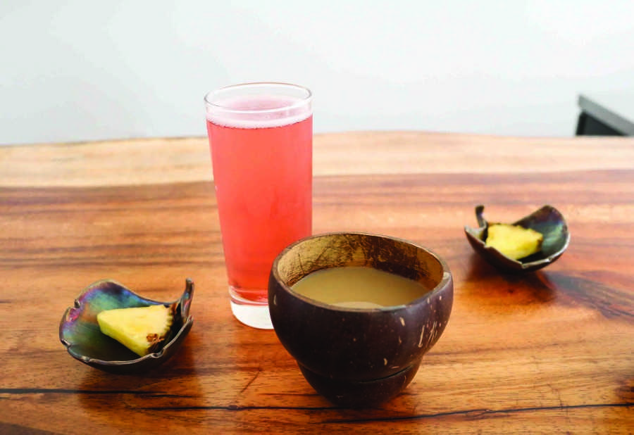 Pineapple+slices+are+used+to+cut+down+the+bitterness+of+the+kava+drink.
