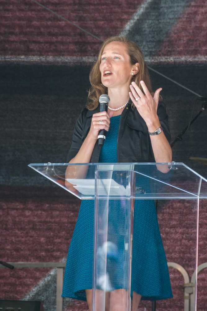 Event organizer Betty Ann Boeving speaks about the Freedom Summit on Saturday at Levi's Stadium.