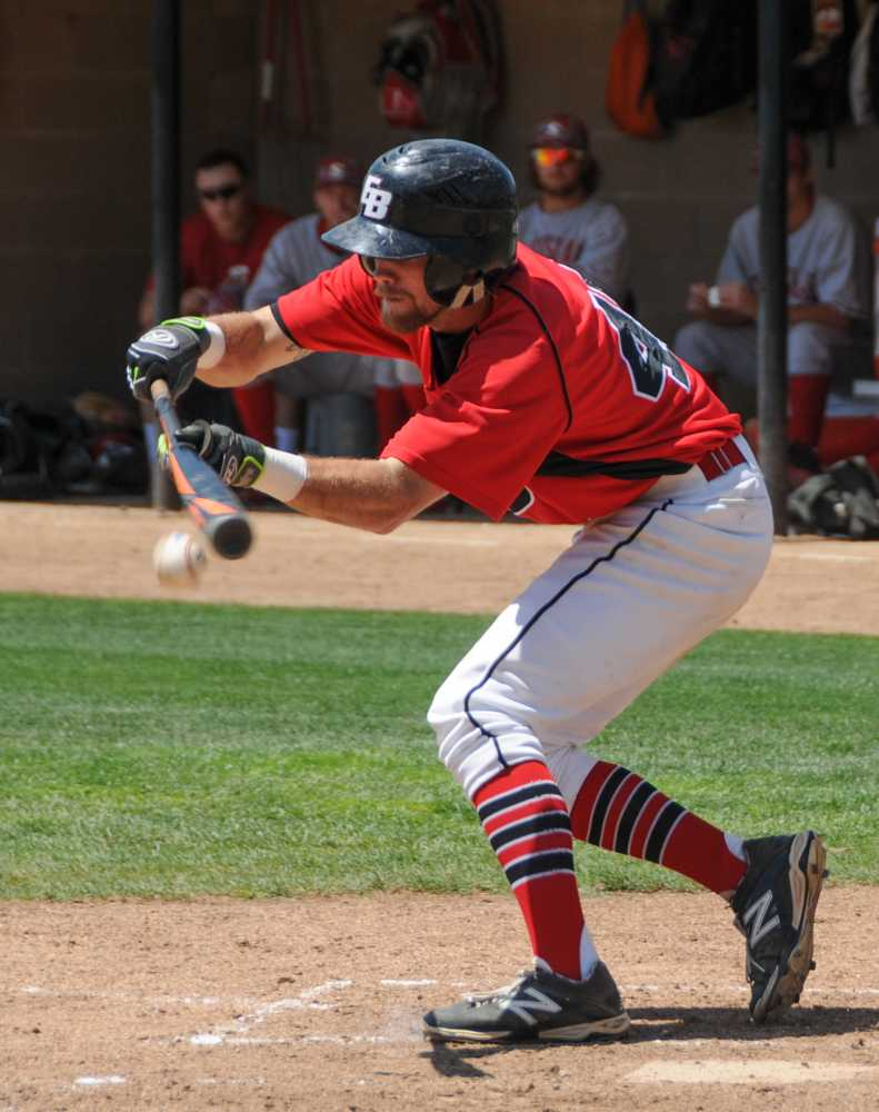 CSUEB junior infielder Ryan Wheat lays down a bunt against Cal State Stanislaus on Sunday.