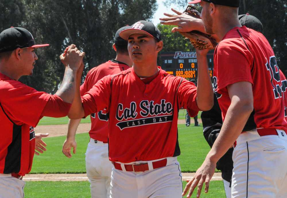 CSUEB freshman pitcher Donavon Ramirez celebrates with his teammates on Sunday after a win over CSUS.