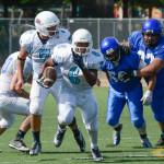 High school rivals battle in alumni football game
