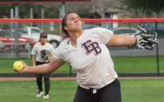 Softball splits season opener on road