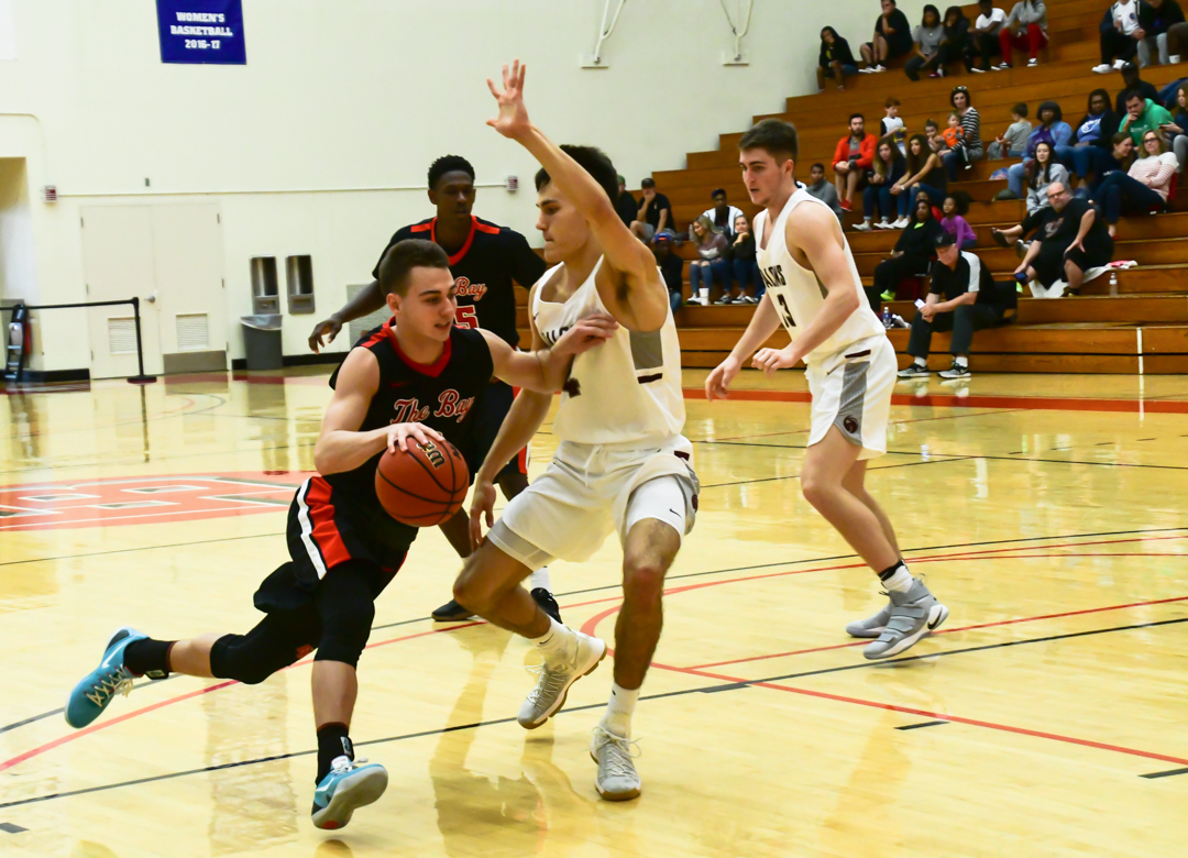 Cal State Eastbay junior guard Jordan Balser dribble across his opponent during the game against Seattle Pacific Falcon held on 11 th November 2017 at Pioneer gymnasium in Hayward.