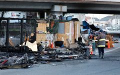 Fires burn Oakland homeless encampment