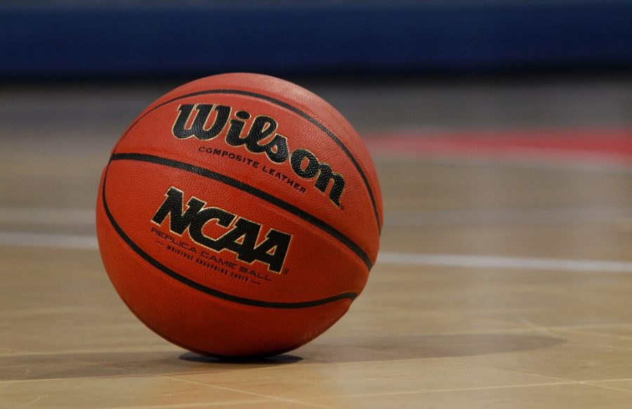 A detail view of an Wilson NCAA basketball is seen on a court at Bracket Town on Sunday April 3, 2011 in Houston, Texas. (AP Photo/Aaron M. Sprecher)