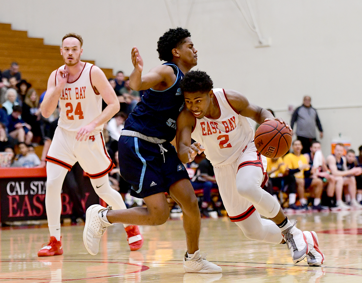 Cal State Eastbay sophomore guard Nai Carlisle dribbles across his opponent during the game against Sonoma State Seawolves held on 16th February 2019 at Pioneer gymnasium, Hayward.