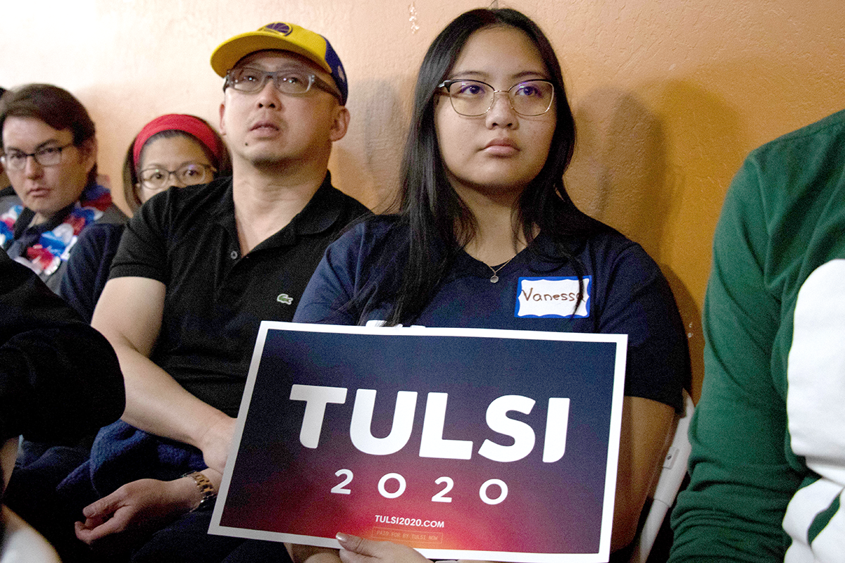 Vanesa Yamat and Lin Lee listen to Rep.Tulsi Gabbard speak during a rally in Fremont on March 17,2019.