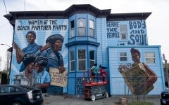 A house at the corner of Dr. Huey P Newton Way and Center Street has been transformed into a giant mural celebrating the Women of the Black Panther Party.