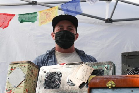 Kaden Hill, owner, and creator of these one-of-a-kind, refurbished audio speakers, on April 24. Hill noted that social media has been the true savior of his business throughout the pandemic. When he heard that the farmers