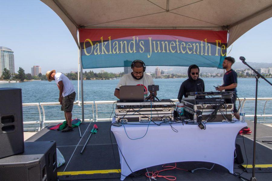 DJs playing music for festival-goers.