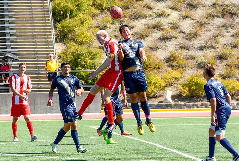 Duke+Driggs+goes+for+a+header+against+Monterey+Bay.