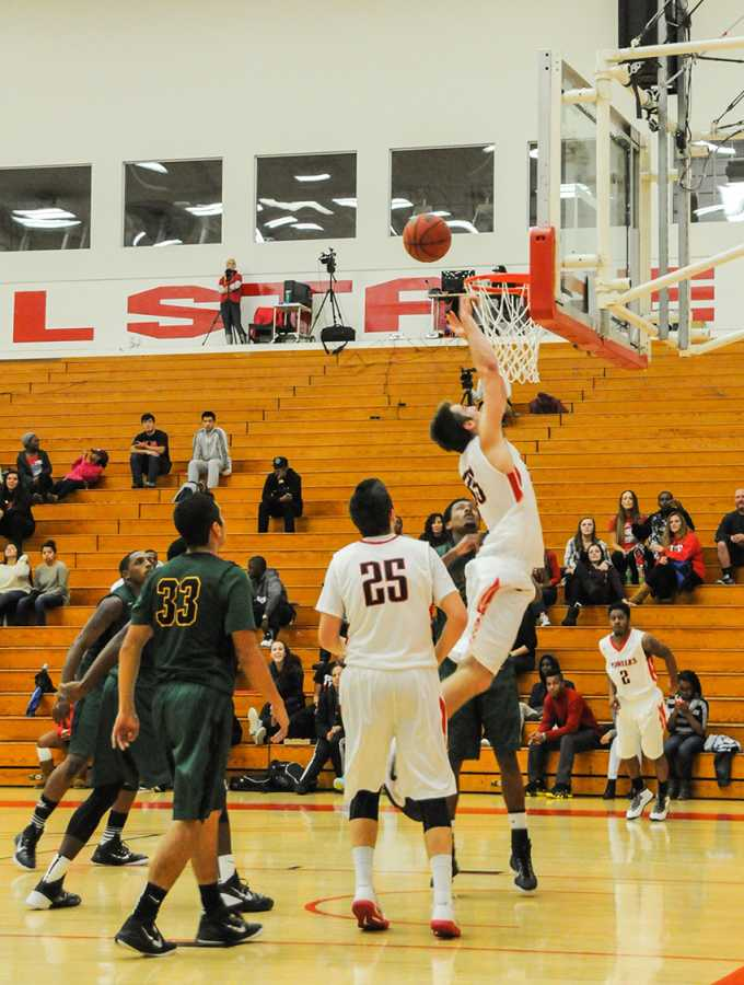 Men's basketball wins first conference game
