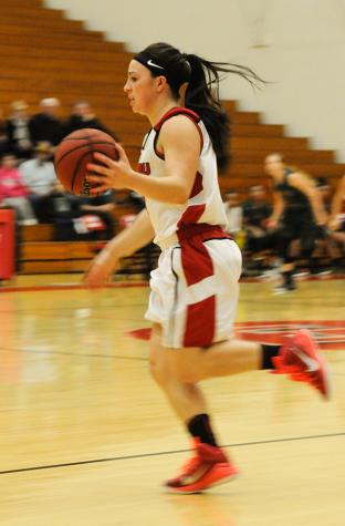 Women's hoops hang on for win