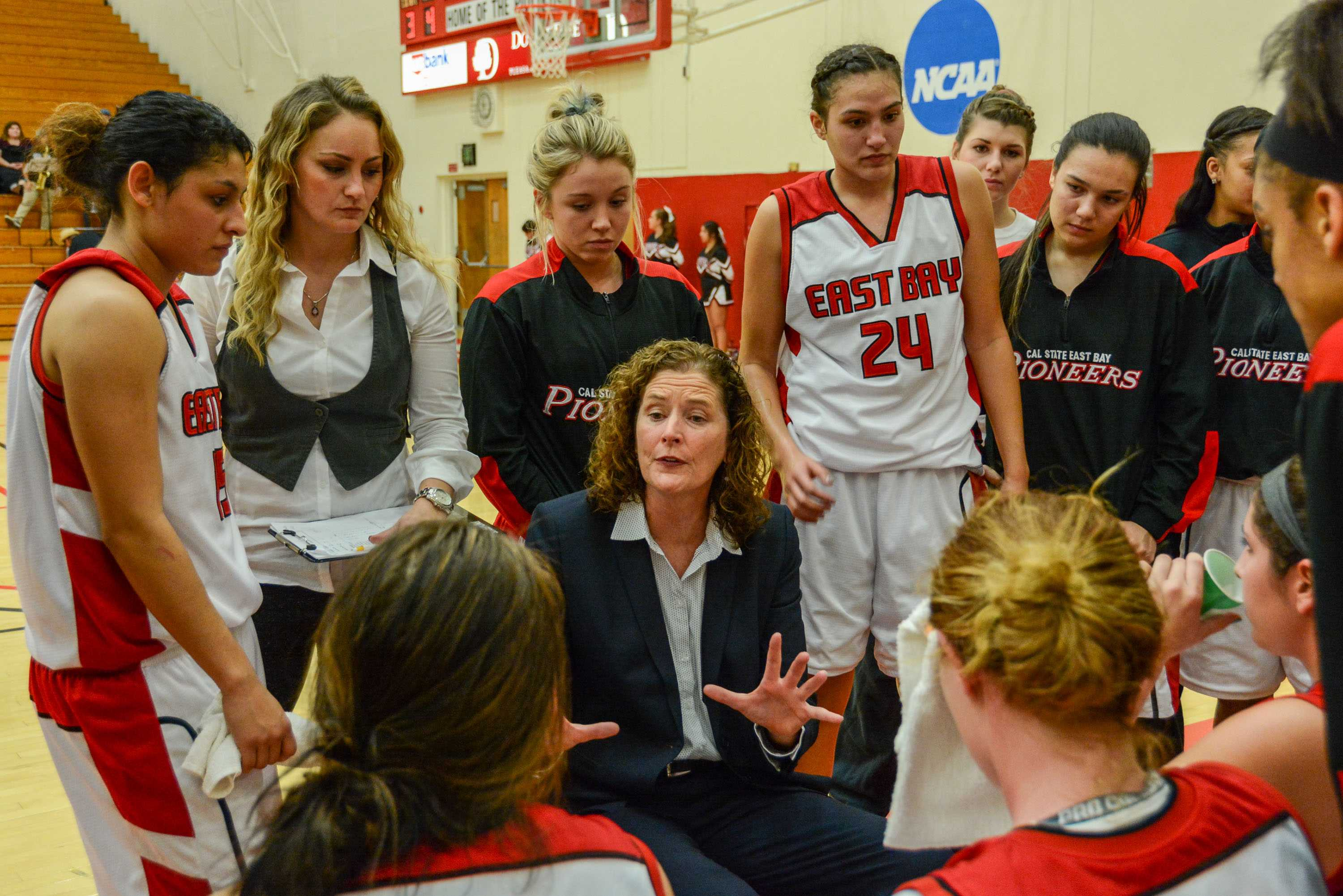 CSUEB Head Coach Suzy Barcomb talks to her team during a timeout in the second half on Saturday.