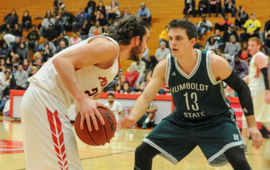 CSUEB senior guard Nick Grieves sizes up a defender on senior night against Humboldt State on Saturday at Pioneer Gymnasium in Hayward.