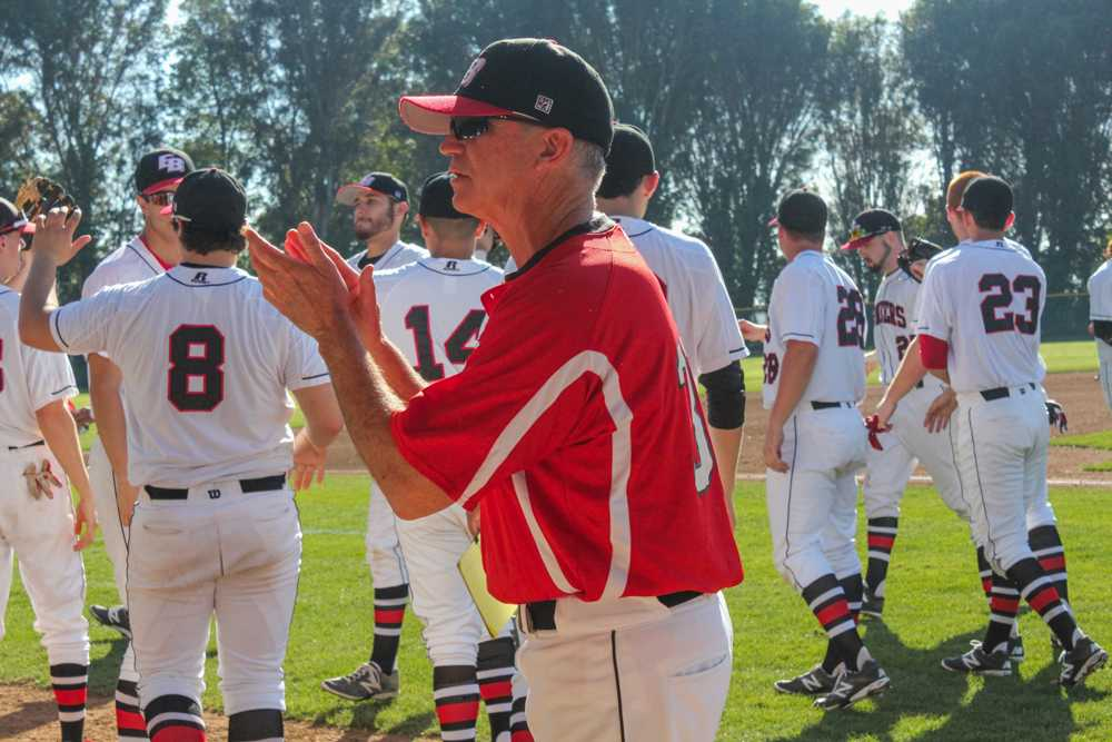 CSUEB baseball team Head Coach Bob Paston celebratesa victory over the Academy of Art University over the weekend at Pioneer Field in Hayward