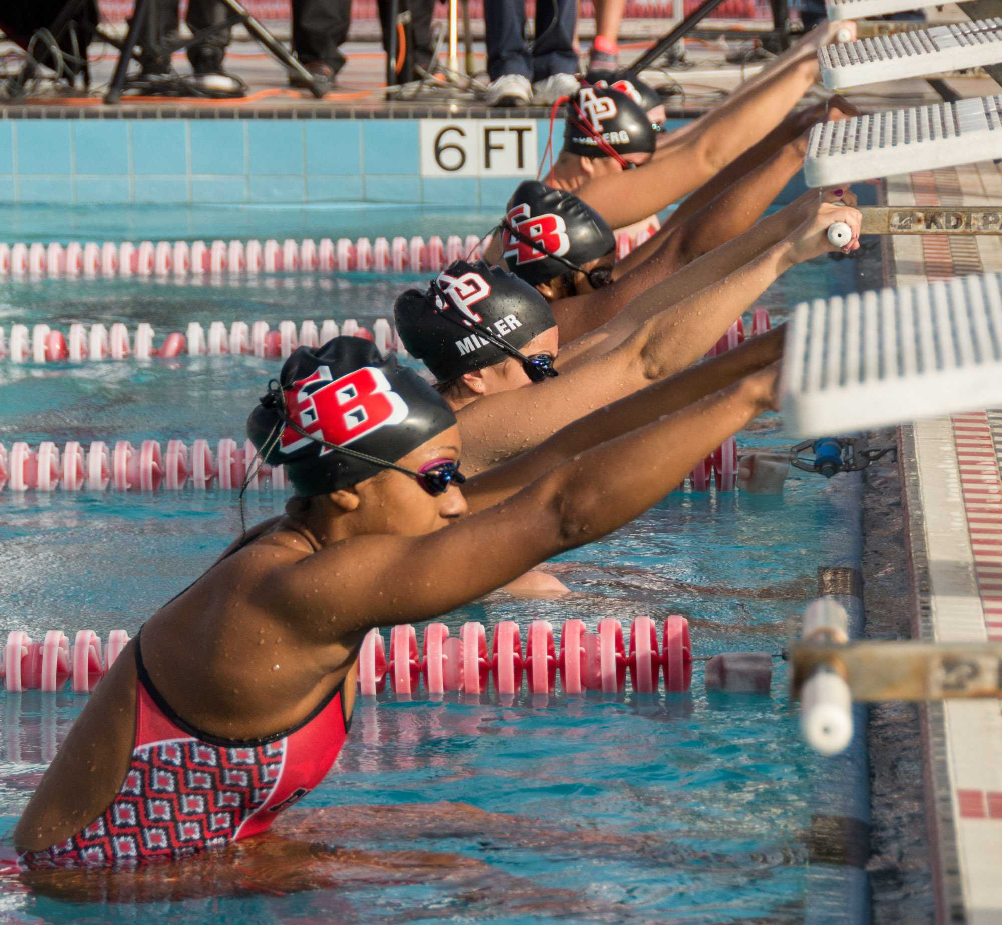 The CSUEB women's swimming team participate in an event at Pioneer Pool in Hayward on senior day.