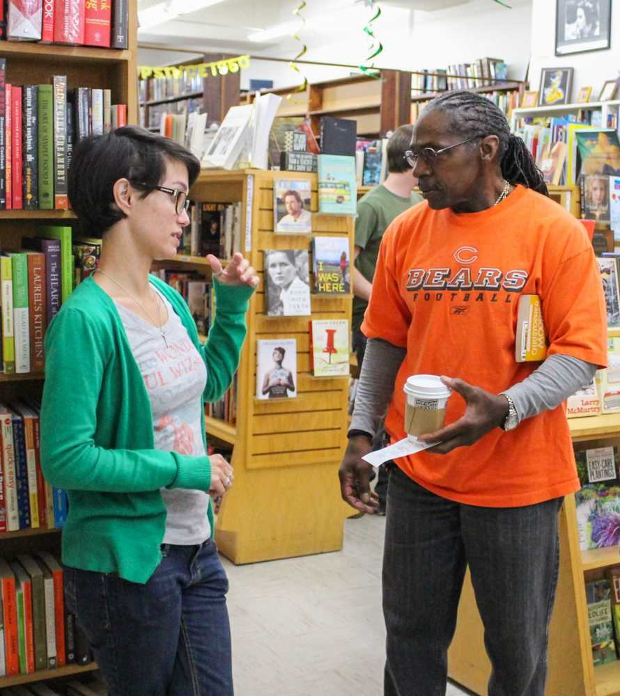 The Book Shop employee, Stephanie Foster, Speaks to store regular Jerry Robinson during the The Book Shop's 55th anniversary celebration in Hayward on Saturday.