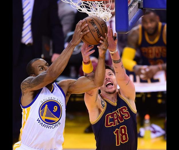 Mike Miller of the Cleveland Cavaliers vies for the ball with Andre Iguodala of the Golden State Warriors in Game 2 of the best of 7 series in the 2015 NBA Finals on June 7, 2015 in Oakland, California.