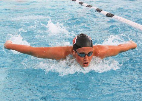 Women's swimming team splits home opener