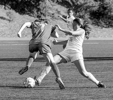 Women's soccer get first road win