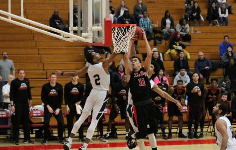 Men's basketball breaks losing streak