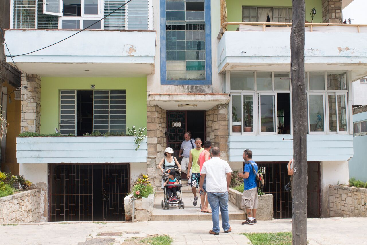 Tourists+coming+out+of+a+casa+particular+in+Central+Havana+around+noon%2C+going+out+and+exploring+what+Havana+has+to+offer.
