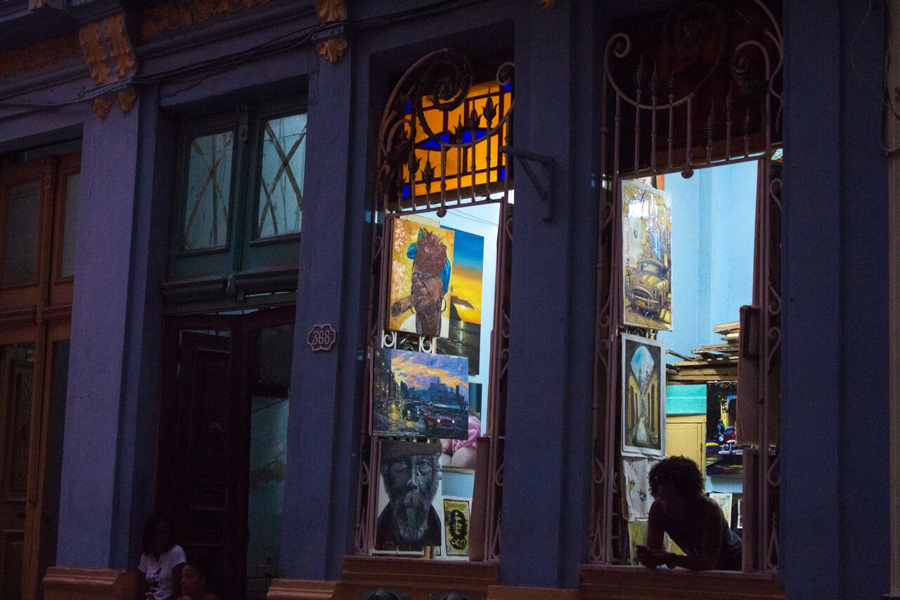 An+owner+of+a+store+in+the+touristy+part+of+Old+Havana+stands+around+waiting+for+people+to+come+in.