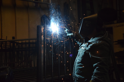 Photographer Yasmine Castañeda's father Lupe Castañeda works on an ornamental iron fence project at his business, Castañeda Iron Works, in an industrial neighborhood of Richmond. Castañeda described ornamental iron as