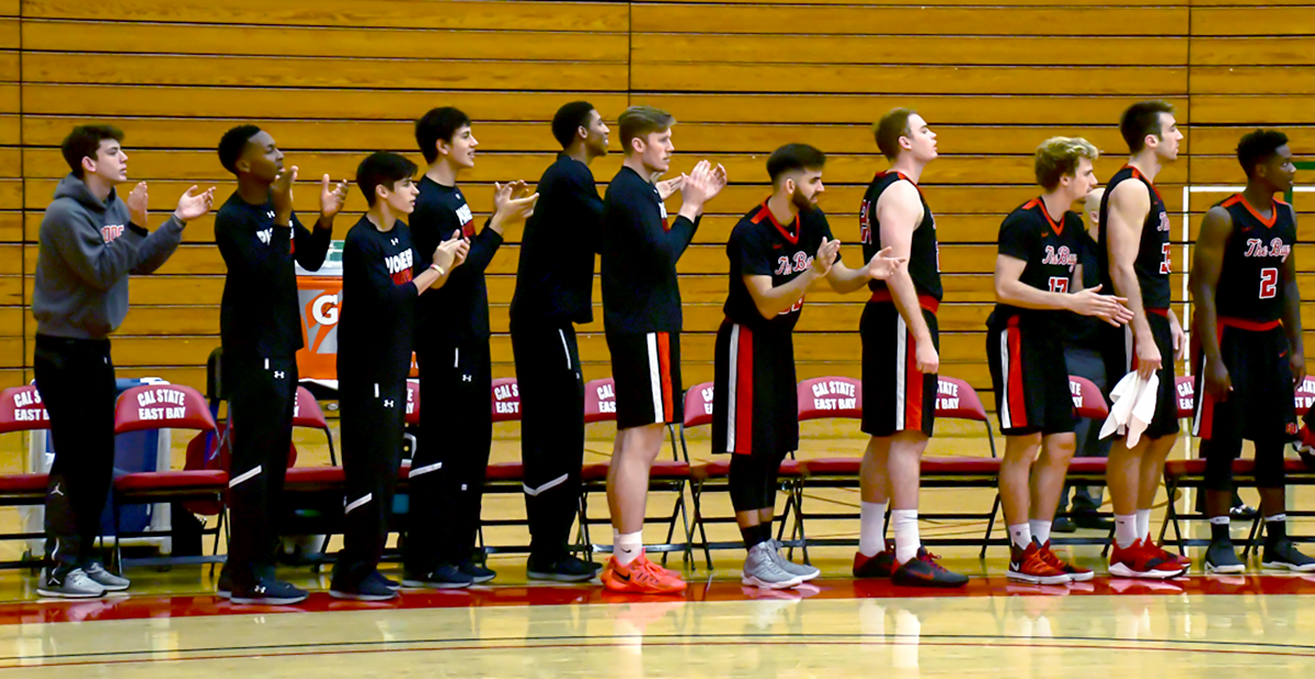Cal State Eastbay Men's Basketball team cheer their teammates during the game against Seattle Pacific Falcon held on Nov. 11, 2017 at Pioneer gymnasium in Hayward.