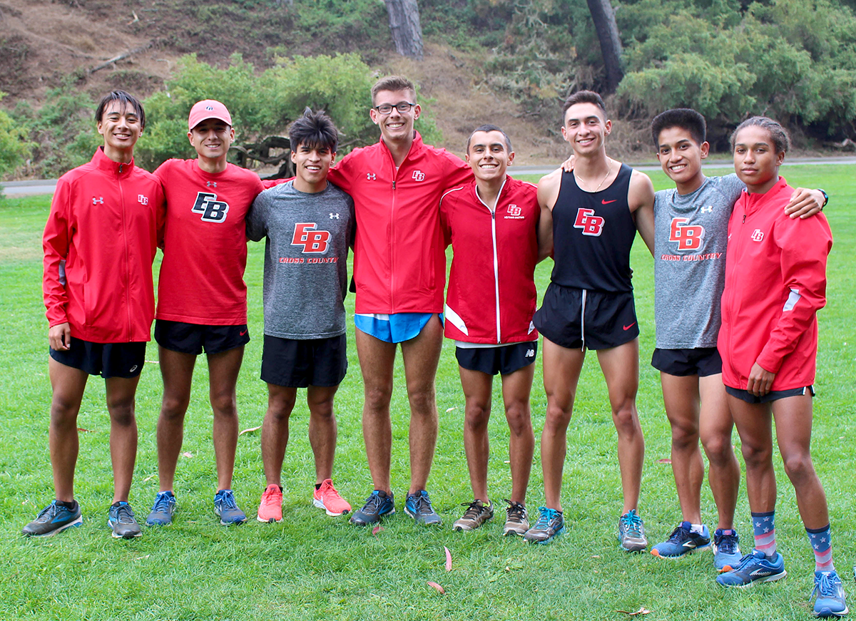 The Men's Cross Country team posing for a photo before warming up for their race.