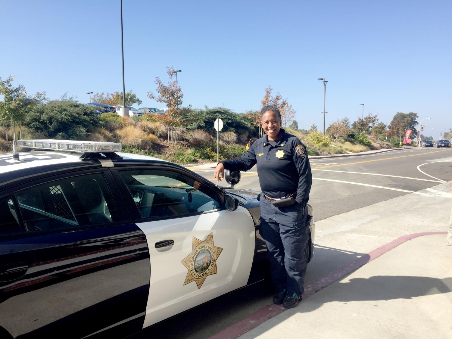 CSUEB's Chief of Police Sheryl Boykins photographed next to a police car.