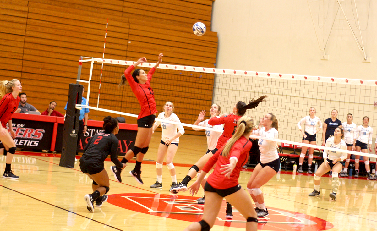 Senior Kathy McKiernan jumps in the air as she records a kill for the Pioneers.