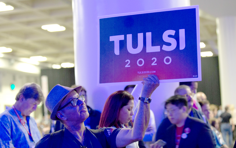 A+Tulsi+Gabbard+supporter+holds+up+a+sign+in+support+of+the+Hawaii+Representative+at+the+California+Democratic+Convention+in+San+Francisco%2C+CA+on+June+1%2C+2019.%0A